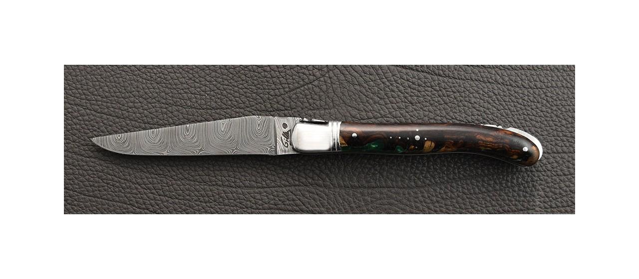 Couteau laguiole de fabrication artisanale, damas et manche en bois de fer et résine époxy