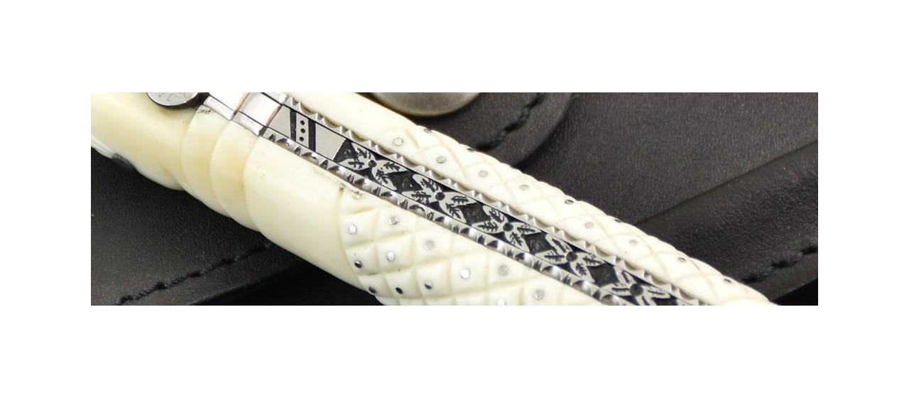 Laguiole delicate filewok damascus blade and genuine bone handle