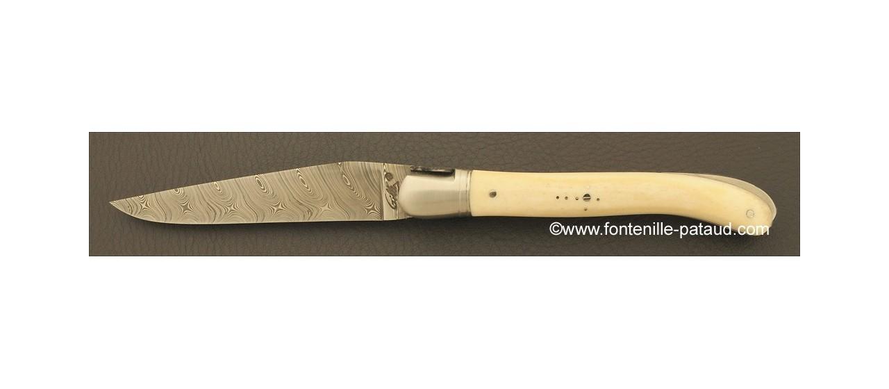 Couteau laguiole en os avec lame en damas haut de gamme